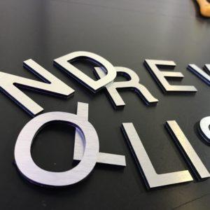 Brushed aluminium lettering