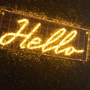 Neon hello sign in cage